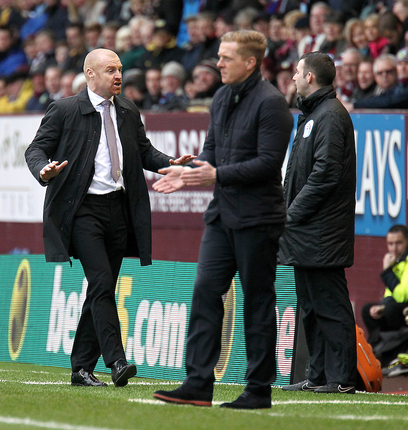 Burnley manager Sean Dyche and Swansea City manager Garry Monk on the touchline<br /> <br /> Photographer Rich Linley/CameraSport<br /> <br /> Football - Barclays Premiership - Burnley v Swansea City - Friday 27th February 2015 - Turf Moor - Burnley<br /> <br /> &copy; CameraSport - 43 Linden Ave. Countesthorpe. Leicester. England. LE8 5PG - Tel: +44 (0) 116 277 4147 - admin@camerasport.com - www.camerasport.com