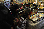 Parishioners kiss icons during Christmas mass at the Christmas Church in Odessa, Ukraine on January 7, 2016.  Orthodox Christians around the world celebrate Christmas on January 7.