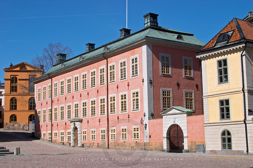 The red pink Stenbockska Palatset on Riddarholmen, seat of the Regeringsrätten court, dating from the 17th century. Stockholm. Sweden, Europe.