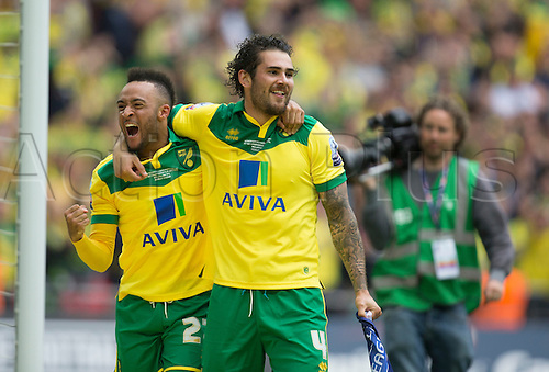 25.05.2015.  London, England. Skybet Championship Playoff Final. Middlesborough versus Norwich. Norwich City's Nathan Redmond shouts in celebrate as he and Bradley Johnson celebrate their side's victory and promotion to the Premier League.