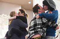 """Keli Gonzales of Rogers (from left) kisses Bekah Hofstra as William Frizzell of Bentonville kisses Rachel Cates during a kissing contest, Sunday, January 26, 2020 during the Kiss the Brides Expo at the Northwest Arkansas Convention Center in Springdale. Check out nwaonline.com/200127Daily/ for today's photo gallery.<br /> (NWA Democrat-Gazette/Charlie Kaijo)<br /> <br /> The annual Kiss the Brides Expo entered its tenth year in Northwest Arkansas with 100 exhibitors, runway shows and games and contests for engaged couples. Over 1,200 people and 400 brides attended the one day event. <br /> <br /> """"The pages of a wedding magazine comes to life,"""" said Ralph Desuse, executive producer of Kiss the Brides Expo."""