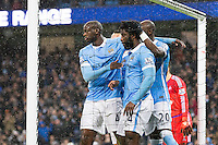 Wilfried Bony celebrates scoring his sides first goal with Yaya Toure and Eliaquim Mangala during the Barclays Premier League Match between Manchester City and Swansea City played at the Etihad Stadium, Manchester on 12th December 2015