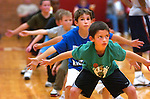 """Players practice their defensive stance as they watch Williamsport High School Head Coach Allen Taylor for the direction to """"slide"""" during Little Millionaires basketball practice at the high school Tuesday, Oct. 26, 2010."""