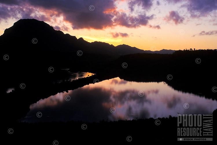Menehune Fishpond (Alekoko) and Huleia River at sunset, near Nawiliwili Kauai. Haupu Mountain in background.