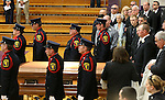 Surrounded by family members, Mournye Landing Dini, right rear, follows her husband's casket into Yerington High School gym. Hundreds of people from around the state attended the funeral of former Assembly Speaker Joe Dini on Tuesday, April 15, 2014, in Yerington, Nev. (Las Vegas Review-Journal/Cathleen Allison)