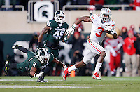 Ohio State Buckeyes wide receiver Michael Thomas (3) dodges a tackle from Michigan State Spartans cornerback Darian Hicks (2) to run a 79 yard touchdown in the second quarter of the college football game between the Ohio State Buckeyes and the Michigan State Spartans at Spartan Stadium in East Lansing, Saturday night, November 8, 2014. As of half time the Ohio State Buckeyes led the Michigan State Spartans 28 - 21. (The Columbus Dispatch / Eamon Queeney)
