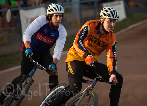 13 SEP 2014 - IPSWICH, GBR - Ben Mould of Wednesfield Aces (right) leads Josh Brooke (left) of Ipswich round a bend during the run off to decide the winner of the 2014 British Open Club Cycle Speedway Championship final at Whitton Sports & Community Centre in Ipswich, Great Britain (PHOTO COPYRIGHT © 2014 NIGEL FARROW, ALL RIGHTS RESERVED)