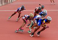 CALI - COLOMBIA - 02-08-2013: Prueba de los 1000 metros Mayores Damas en patinaje de Velocidad en los IX Juegos Mundiales Cali, agosto 2 de 2013. (Foto: VizzorImage / Luis Ramirez / Staff). Competition of 1000 meters Senior Ladies in Speed Skating in the IX World Games Cali, August 2 2013. (Photo: VizzorImage / Luis Ramirez / Staff).