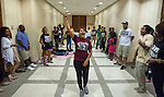 TALLAHASSEE, FL - AUGUST 5, 2013:   Annie Thomas, from Miami, leads the Dream Defenders in a rally outside the governor's office in the lobby of the Florida State Capitol.  The Dream Defenders have been occupying the governors office and the state capitol 24 hours a day for 21 consecutive days protesting Florida's Stand Your Ground law.  <br />