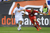 Washington, D.C.- May 29, 2014. Honduras forward Jerry Bengston goes against Turkey defender Omer Toprak.  Turkey defeated Honduras 2-0 during an international friendly game at RFK Stadium.