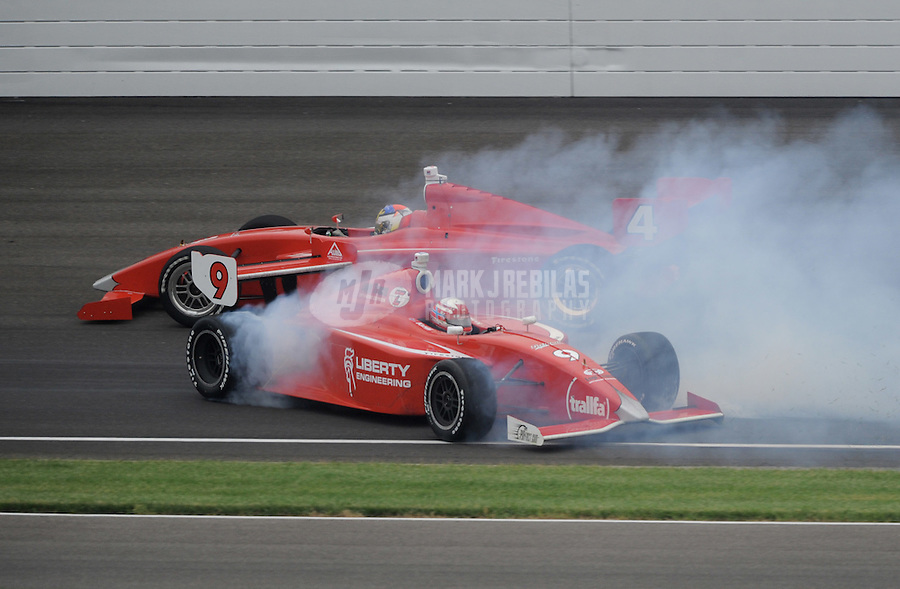 May 28, 2011; Indianapolis, IN, USA; Indy Light driver Anders Krohn (9) spins alongside Jorge Goncalvez (4) during the Freedom 100 at the Indianapolis Motor Speedway. Mandatory Credit: Mark J. Rebilas-