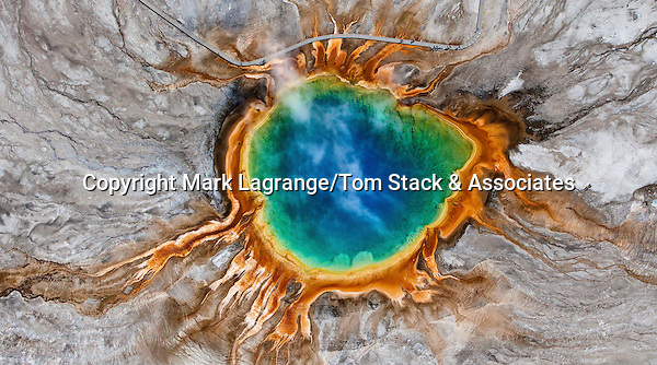 Grand Prismatic Spring, Yellowstone National Park, Wyoming For perspective, note the boardwalk with people enjoying their stroll through the steam of this beautiful wonder of the world.