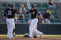 Antonio Rodriguez (6) of the Kannapolis Intimidators high fives teammate Seby Zavala (21) after hitting a 2-run home run against the Asheville Tourists at Kannapolis Intimidators Stadium on May 27, 2016 in Kannapolis, North Carolina.  The Tourists defeated the Intimidators 7-6.  (Brian Westerholt/Four Seam Images)