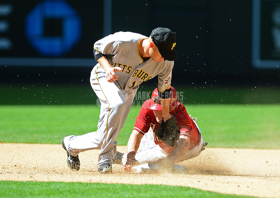 Apr. 18, 2012; Phoenix, AZ, USA; Pittsburgh Pirates shortstop Clint Barmes tags out Arizona Diamondbacks base runner A.J. Pollock on a stolen base attempt in the seventh inning at Chase Field.  Mandatory Credit: Mark J. Rebilas-