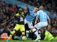 2nd November 2019; Etihad Stadium, Manchester, Lancashire, England; English Premier League Football, Manchester City versus Southampton; Moussa Djenepo of Southampton competes for the ball with Phil Foden and Angelino of Manchester City - Strictly Editorial Use Only. No use with unauthorized audio, video, data, fixture lists, club/league logos or 'live' services. Online in-match use limited to 120 images, no video emulation. No use in betting, games or single club/league/player publications