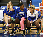 Marymount's Stephanie Symons, Morgan McAlpin and Kelsey Sanna talk on the sidelines during a college volleyball match against PSU Harrisburg at Marymount University in Arlington, Vir., on Wednesday, Oct. 9, 2013.<br /> Photo by Cathleen Allison
