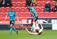 Michael Smith of Rotherham United high challenge on Nathan Pond of Fleetwood Town during the Sky Bet League 1 match between Rotherham United and Fleetwood Town at the New York Stadium, Rotherham, England on 7 April 2018. Photo by Leila Coker.