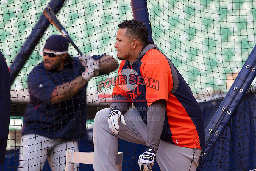 Detroit Tigers third baseman Miguel Cabrera (24) near the batting cage as teammate Prince Fielder warms up before the MLB baseball game against the Houston Astros on May 3, 2013 at Minute Maid Park in Houston, Texas. Detroit defeated Houston 4-3. (Andrew Woolley/Four Seam Images).