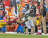 Seattle Seahawks wide receiver Doug Baldwin (89) is tackled by Washington Redskins free safety Ryan Clark (25) in second quarter action at FedEx Field in Landover, Maryland on Monday, October 6, 2014.<br /> Credit: Ron Sachs / CNP