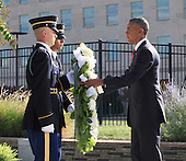 United States President Barack Obama lays a wreath at the Pentagon Memorial in Washington, DC during an observance ceremony to commemorate the 15th anniversary of the 9/11 terrorist attacks, Sunday, September 11, 2016. <br /> Credit: Dennis Brack / Pool via CNP