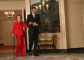 Washington, DC - June 2, 2009 -- United States President Barack Obama escorts former first lady Nancy Reagan to the signing of the Ronald Reagan Centennial Commission Act in the Diplomatic Reception Room of the White House on Tuesday, June 2, 2009..Credit: Dennis Brack / Pool via CNP