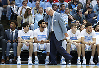 CHAPEL HILL, NC - FEBRUARY 25: Head coach Roy Williams of the University of North Carolina holds his head in frustration during a game between NC State and North Carolina at Dean E. Smith Center on February 25, 2020 in Chapel Hill, North Carolina.