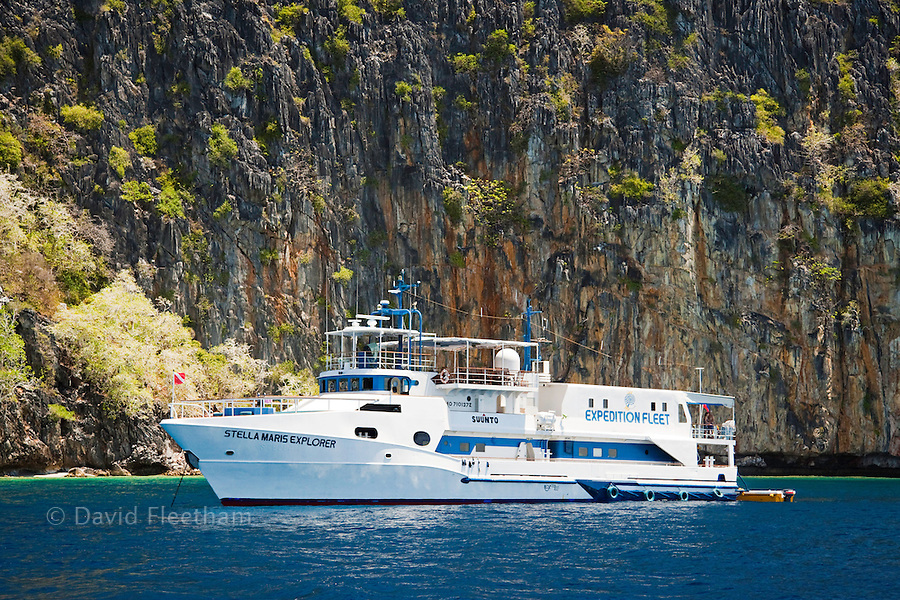Stella Maris Explorer, part of the Expedition Fleet Live-Aboard Dive Boats, at anchor off Quiminatin island, part of the Cuyo Archipelago just north of the Sulu Sea in the Philippines.