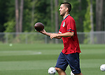 Clint Dempsey plays catch with an American football on Thursday, May 11th, 2006 at SAS Soccer Park in Cary, North Carolina. The United States Men's National Soccer Team held a training session as part of their preparations for the upcoming 2006 FIFA World Cup Finals being held in Germany.