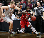 SIOUX FALLS, SD - MARCH 12:  Joel Okafor #20 from Indiana Wesleyan dries past Nate Niehoff #34 from IU East during their semifinal game at the 2018 NAIA DII Men's Basketball Championship at the Sanford Pentagon in Sioux Falls. (Photo by Dave Eggen/Inertia)
