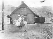 2 ladies on donkey at Lake City depot.<br /> D&amp;RG  Lake City, CO
