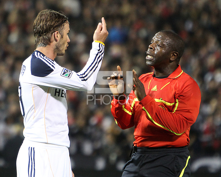 David Beckham (23) of the Los Angeles Galaxy with referee Abiodun Okulaja during an MLS match against D.C. United at RFK Stadium, on April 9 2011, in Washington D.C. The game ended in a 1-1 tie.
