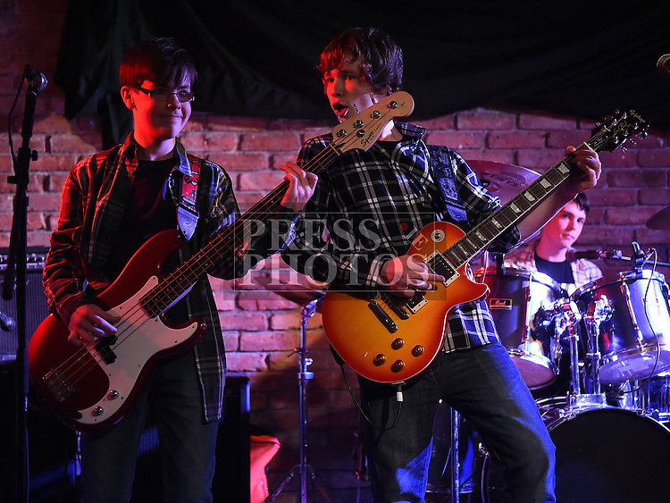 Sean Orr aged 13 on Bass, Jaime Orr aged 15 on guitar and Jake Hyland aged 15 on drums collectively known as Bruse pictured at the Rock for Ryan event at The Venue in McHugh's. Photo:Colin Bell/pressphotos.ie