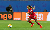 GRENOBLE, FRANCE - JUNE 15: Ashley Lawrence #10 of the Canadian National Team controls the ball during a game between New Zealand and Canada at Stade des Alpes on June 15, 2019 in Grenoble, France.