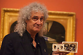 "London, United Kingdom. 20 October 2014. Photocall with astrophysicist and Queen's guitarist Dr Brian May at Tate Britain for the exhibition ""Poor Man's Picture Gallery: Victorian Art and Stereoscopic Photography"", running until 12 April 2015. In front of the picture Chatterton, 1856, by Henry Wallis. Brian May has lent a rare collection of Victorian stereographic photographs to Tate Britain that are featured in the exhibition. This is the first display in a major British art gallery devoted to the 19th century craze of three-dimensional photography, known as stereographs. Some photographs are mounted side by side with oil paintings that inspired painters. Photo: Bettina Strenske"