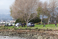 East Bay Regional Park District Police and Alameda County Sheriff's Deputies have taped off a small section of trail at Martin Luther King Jr. Regional shoreline near where a body was discovered on the mudflats.  It was spotted by volunteers participating in a clean-up project on Martin Luther King Day.