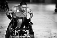 A Colombian disabled athlete in action during a wheelchair rugby training match at the indoor sporting arena Coliseo in Bogota, Colombia, 11 April 2013. Wheelchair rugby, a full-contact team sport, was developed in Canada in 1977 under the name murderball. The game is played only by athletes with some form of disability in both the upper and lower limbs (quadriplegics). Attempting to score by carrying the ball across the goal line, four players from each team roughly crash into each other in specially designed armored wheelchairs. Although the team from Bogota is supported by a foundation (gear), quad rugby players, mostly coming from the remote, socially deprived neighbourhoods, often can not attend a training due to lack of funds for transportation. However, they still dream of representing Colombia at Rio 2016 Paralympic Games.