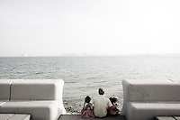 Qatar - Doha - Father and daughters enjoying the view on the other side of the bay.