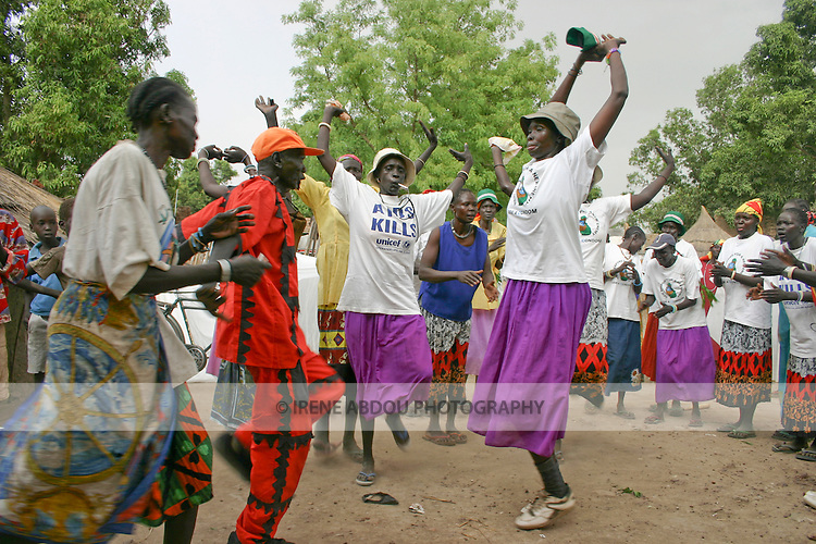 "In Rumbek, South Sudan, Dinka men and women hold their arms up high to symoblize cow horns while jumping in this traditional ""jumping dance."""