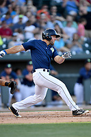 Left fielder Tim Tebow (15) of the Columbia Fireflies bats in a game against the West Virginia Power on Friday, May 19, 2017, at Spirit Communications Park in Columbia, South Carolina. West Virginia won, 3-1. (Tom Priddy/Four Seam Images)