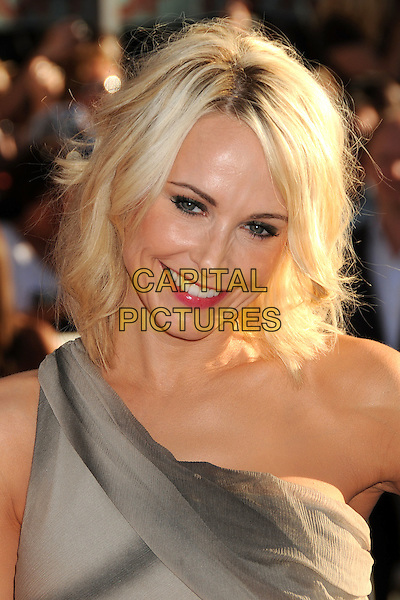 "Josie Bissett.""Captain America: The First Avenger"" Los Angeles Premiere held at the El Capitan Theatre, Hollywood, California, USA..July 19th, 2011.headshot portrait grey gray one shoulder pink lipstick smiling  .CAP/ADM/BP.©Byron Purvis/AdMedia/Capital Pictures."