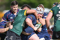 Ewan McQuillin of London Scottish is tackled during the Greene King IPA Championship match between London Scottish Football Club and Nottingham Rugby at Richmond Athletic Ground, Richmond, United Kingdom on 15 April 2017. Photo by David Horn.