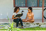 Girlswith pet duck and albino gecko in Funafuti, Tuvalu