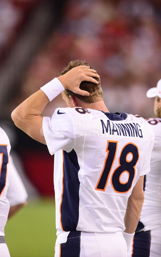 Aug. 30, 2012; Glendale, AZ, USA; Denver Broncos quarterback (18) Peyton Manning reacts on the sidelines against the Arizona Cardinals during a preseason game at University of Phoenix Stadium. Mandatory Credit: Mark J. Rebilas-