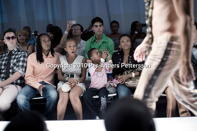 JOHANNESBURG, SOUTH AFRICA - MARCH 27: Models show clothes at the South African fashion week on March 27, 2010, Turbine Hall in central Johannesburg, South Africa. Buyers and celebrities watched the 3 day fashion week, a biannual event. (Photo by Per-Anders Pettersson)