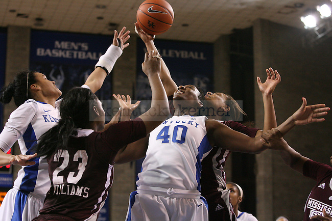 UK senior forward Brittany Henderson and junior forward/center Samantha Drake fight Mississippi State players for a rebound at Memorial Coliseum on Thursday, January 17, 2013 in Lexington, Ky.  Photo by Adam Pennavaria | Staff