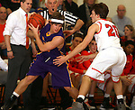 SIOUX FALLS, SD - JANUARY 21:  Mark DeSpiegler #20 from Watertown tries to keep the ball from the defense of Carter Keller #20 from Washington in the first half of their game Tuesday night at Washington. (Photo by Dave Eggen/Inertia)