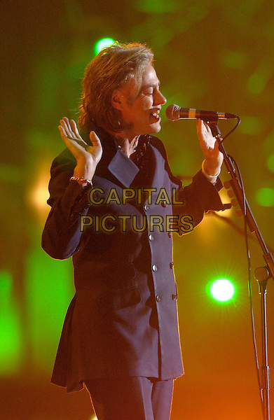BOB GELDOF.Brit Awards 2005 - Live Performance.Earls Court 2, London, SW5.February 9th, 2005.half length, stage, concert, show, music, live gig singing profile hands gesture.www.capitalpictures.com.sales@capitalpictures.com.©Capital Pictures