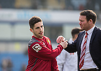 Darren Sarll of Stevenage with Tom Pett of Stevenage during the Sky Bet League 2 match between Wycombe Wanderers and Stevenage at Adams Park, High Wycombe, England on 12 March 2016. Photo by Andy Rowland/PRiME Media Images.