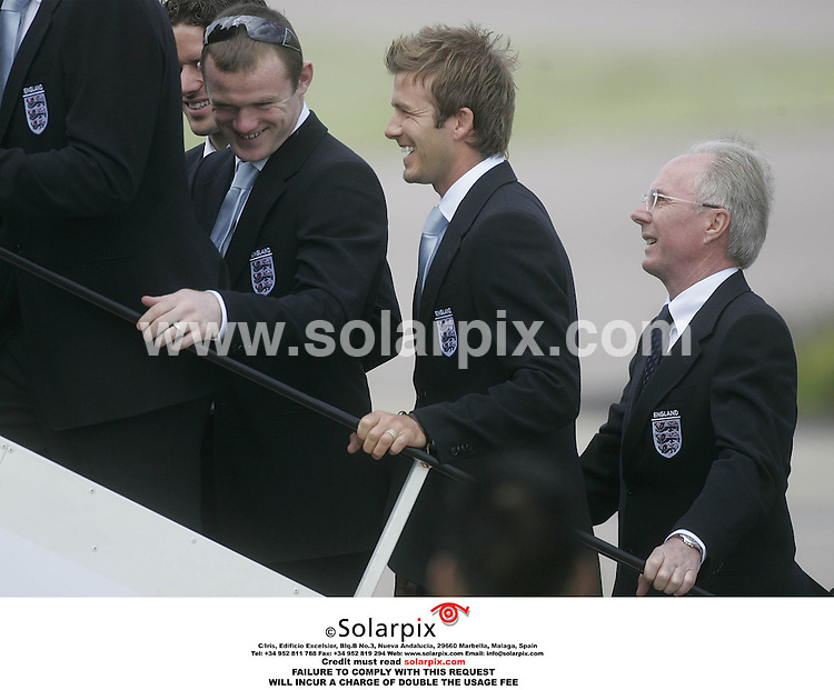 ALL ROUND PICTURES FROM SOLARPIX.COM.*MUST CREDIT SOLARPIX.COM OR DOUBLE FEE WILL BE CHARGED*.**NO PUBLICATION IN FRANCE, SCANDANAVIA, AUSTRALIA AND GERMANY FOR PUBLICATION IN THE UK MAGAZINES**.The England captain David Beckham and Wayne Rooney board the England squad's plane at Luton Airport as the team prepare to fly to Germany for the Football World Cup..THIS PIC:WAYNE ROONEY,DAVID BECKHAM,SVEN ERRICKSON..DATE:05.06.06-JOB REF:2457-SFE