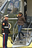 Washington, DC - February 16, 2009 -- Malia Obama, eldest daughter of United States President Barack Obama adjusts her backpack as she returns to the South Lawn of the White House aboard Marine 1after spending a week-end in Chicago, Illinois on Monday, February 16, 2009..Credit: Ron Sachs - Pool via CNP